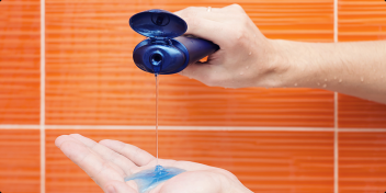 Pouring Antibacterial Body Wash onto a hand during a shower